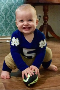 Ready, set, hut...Patrick Devore, 16 months, is ready for action. He's the great-grandson of ND captain and coach Hugh Devore.